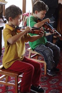 children playing violins